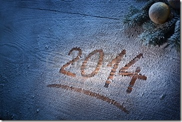 23321365-new-year-2014-on-snow-covered-wooden-desk